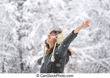 Young woman celebrating winter