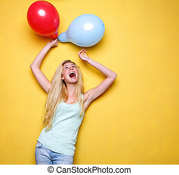 Young woman celebrating with balloons