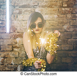 Young woman celebrating with fireworks