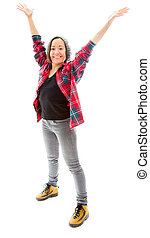 Young woman celebrating with her arms raised
