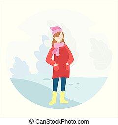 Girl walks in the winter in the park.
