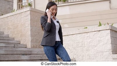 Young woman chatting on her mobile