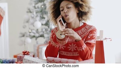 Young woman chatting on her mobile at Christmas