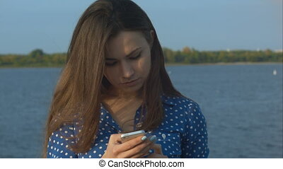 Young woman checking her messages. Closeup.