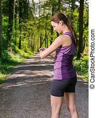 Young woman checking her running time