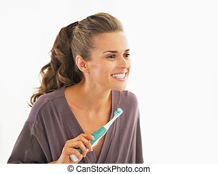 Young woman checking teeth after brushing