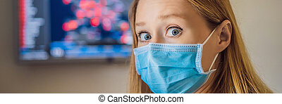Young woman checks coronavirus sars-cov-2 covid-19 global cases situation online. Coronavirus outbreak in United States of America and World. BANNER, LONG FORMAT