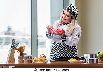 Young woman chef preparing dessert cak