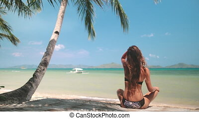 young woman chilling on philippines paradise beach