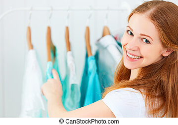 woman chooses clothes in her wardrobe