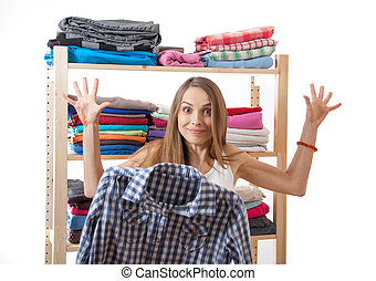 young woman chooses clothes