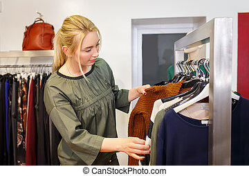 young woman chooses in the store