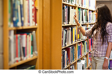 Young woman choosing a book