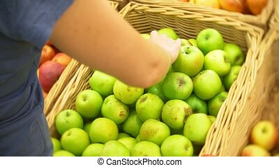 young woman choosing apple at fruit vegetable supermarket marketplace. 4k