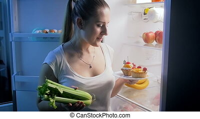 Young woman choosing healthy food instead of sweets. Concept...