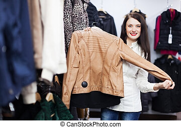 Young woman choosing jacket