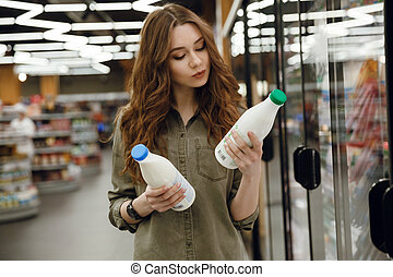 Young woman choosing milk