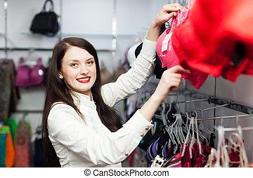Young woman choosing underwear