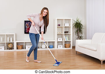 Young Woman Cleaning Floor - Portrait Of Young Woman Mopping...