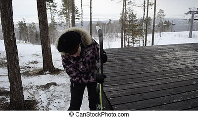 young woman cleans snow skiing