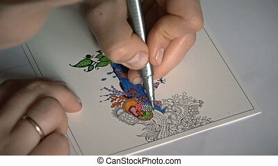 Young woman coloring an anti stress mandala - Coloring for...