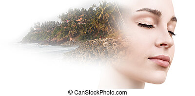 Double exposure portrait of young woman combined with photograph of nature.