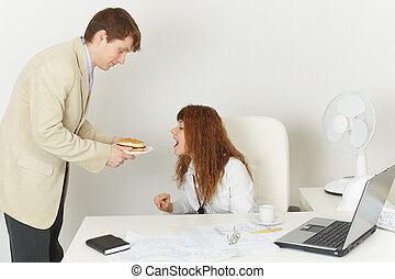 Young woman comically reaches for meal during the lunchtime