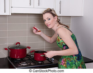 young woman cooking dinner