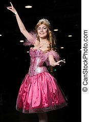 Young woman cosplayer wearing pink dress