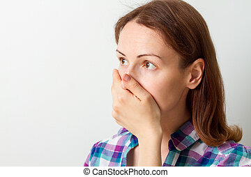 young woman covered her mouth with her hand