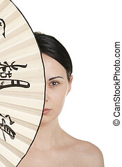 Young woman covered with fan