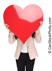 woman covering her face with a big red heart shape