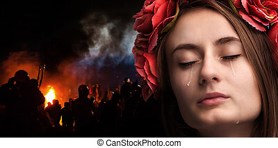 young woman crying - Patriotic concept. Ukraine in fire....