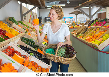 young woman customer in fruit store