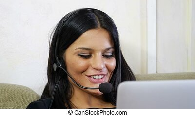 Young woman, customer service operator with headset