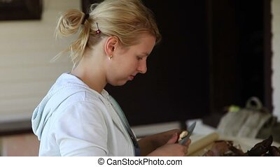 Young woman cutting mushrooms