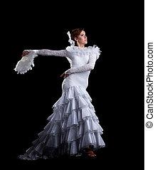 Young woman dance in white flamenco costume