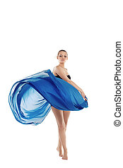 Young woman dance with fly blue cloth