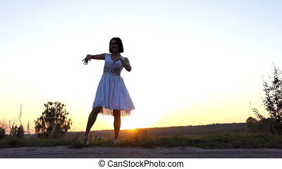Young Woman Dances Disco to Her Boyfriend at Sunset in Slow Motion