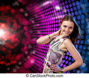 young woman dancing at disco or a night club