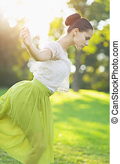 Young woman dancing in forest