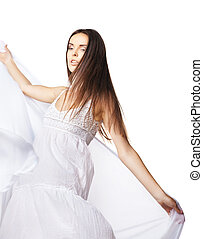 Young woman dancing in gorgeous white dress