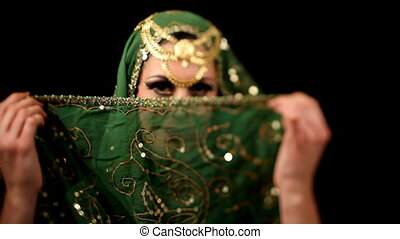 young woman dancing in oriental style dress