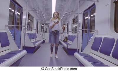 Young woman dancing in subway train