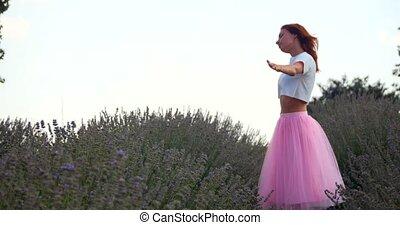 Young woman dancing in the lavanda field