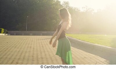 Young woman dancing on the square