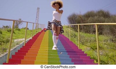 Young Woman Dancing On The Stairs.