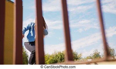 Young Woman Dancing Outside - A young woman dancing outside...