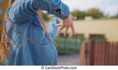 Young Woman Dancing Outside - A young woman dancing outside....