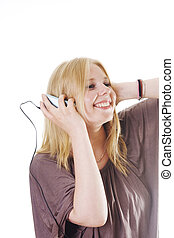 young woman dancing with mp3